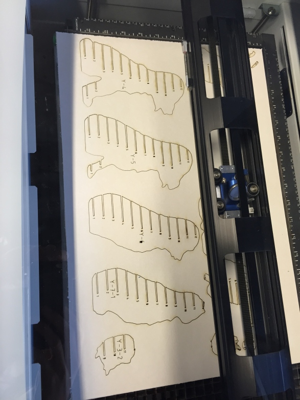 Lasercutting interlocking slices to make a 3D dog model.
